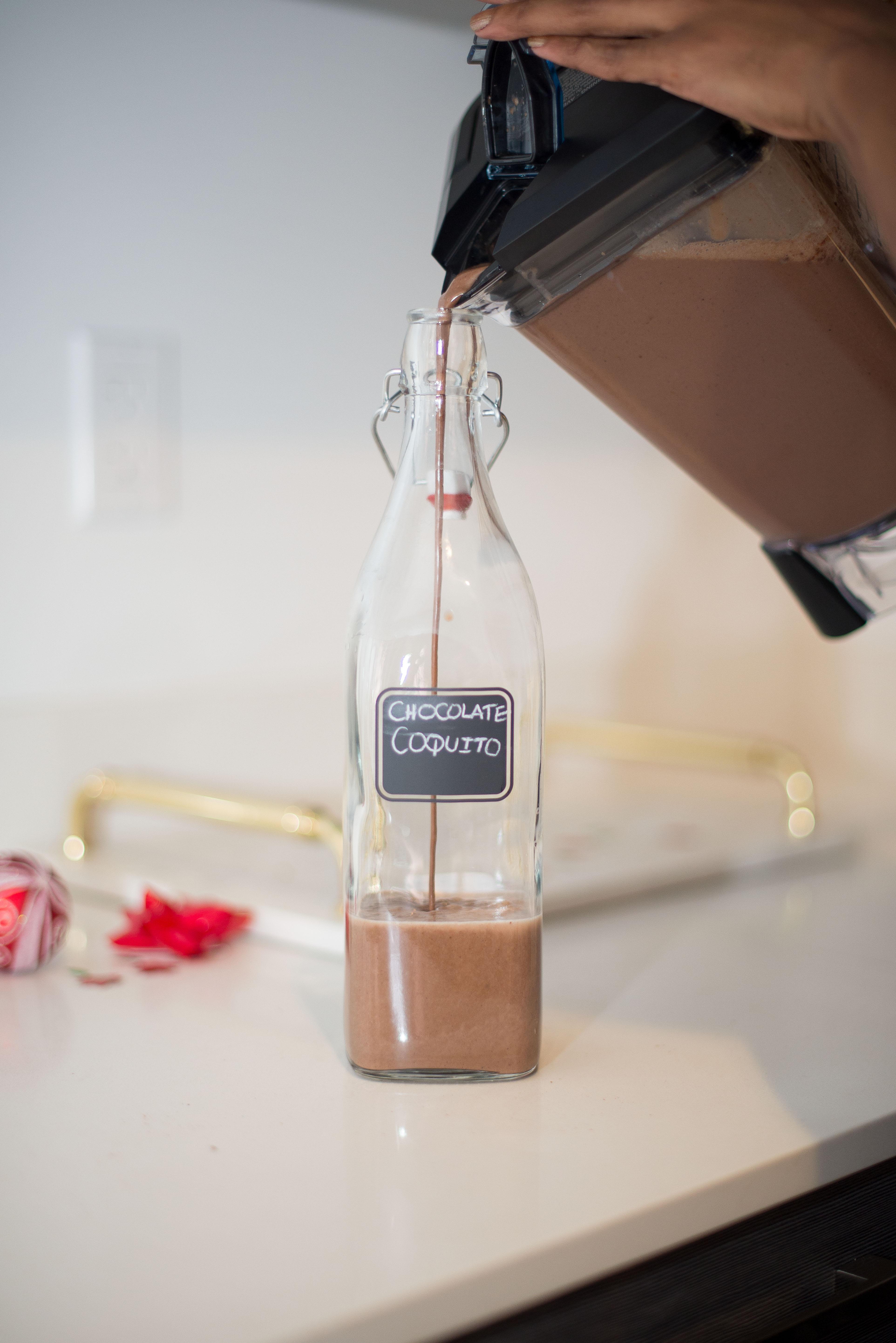 Chocolate_Coqutio_Recipe_Puerto_Rican_Egg_Nog_pouring_coquito